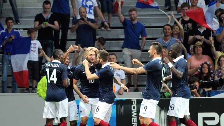 Karim Benzema (centre): Congratulated after scoring in 8-0 win over Jamaica
