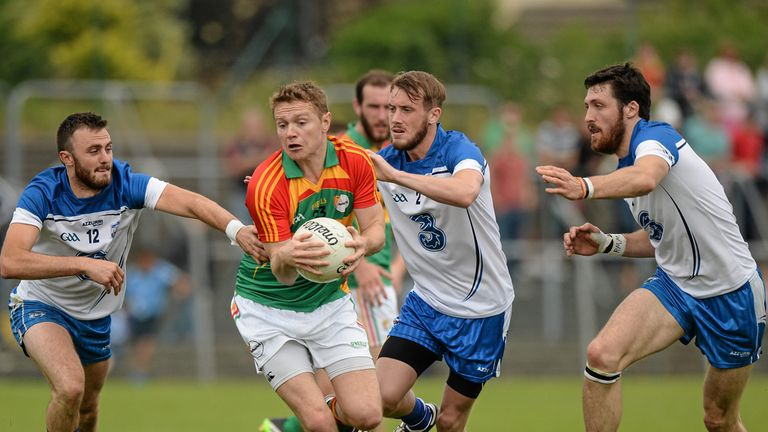 Carlow's Willie Minchin is tracked by three Waterford players