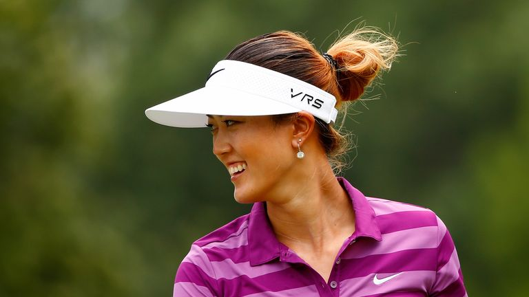 ROGERS, AR - JUNE 28:  Michelle Wie smiles after a shot on the nineth hole during the second round of the Walmart NW Arkansas Championship Presented by PG