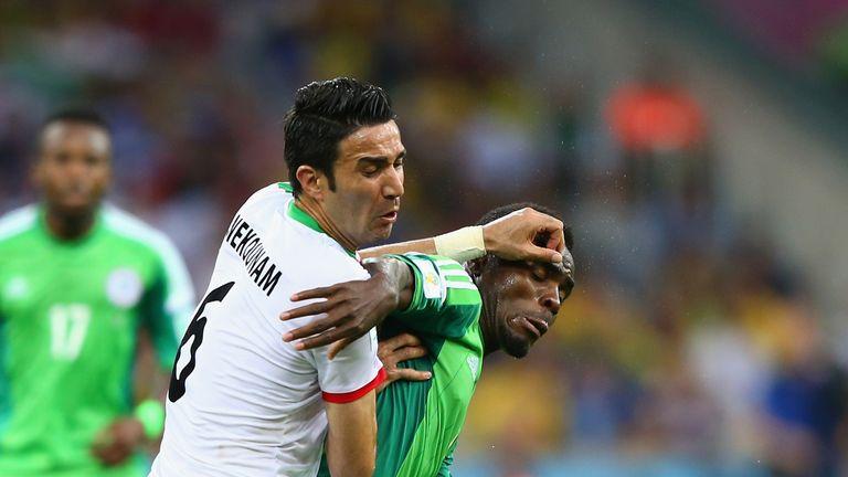 Javad Nekounam competes with Emmanuel Emenike
