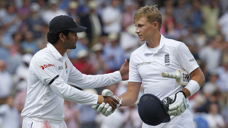 Dimuth Karunaratne shakes Joe Root's hand after the England batsman hit 200 not out on day two of first Test against Sri Lanka, June 13, 2014.