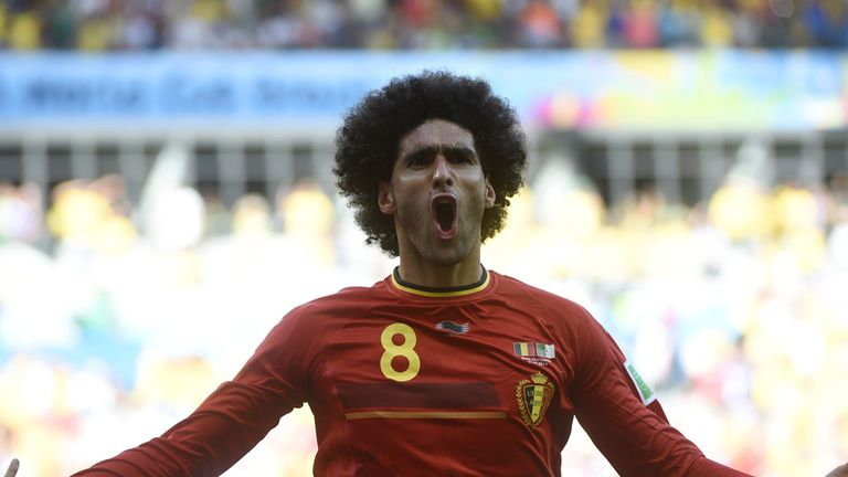 Marouane Fellaini: Celebrates after scoring the equaliser for Belgium