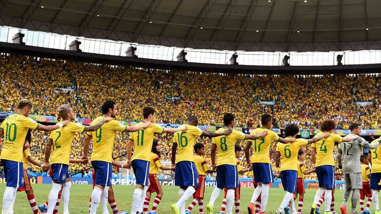The Brazil players enter the field together