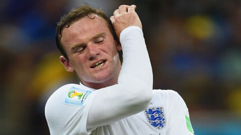 Wayne Rooney reacts during England's loss to Italy