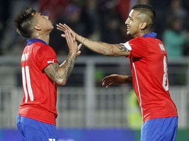Chile's Eduardo Vargas celebrates with Arturo Vidal