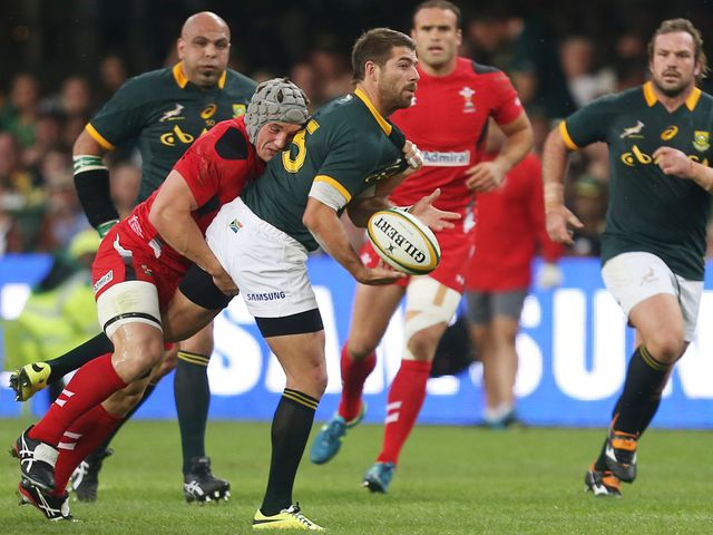 Jonathan Davies with a tackle on Willie le Roux