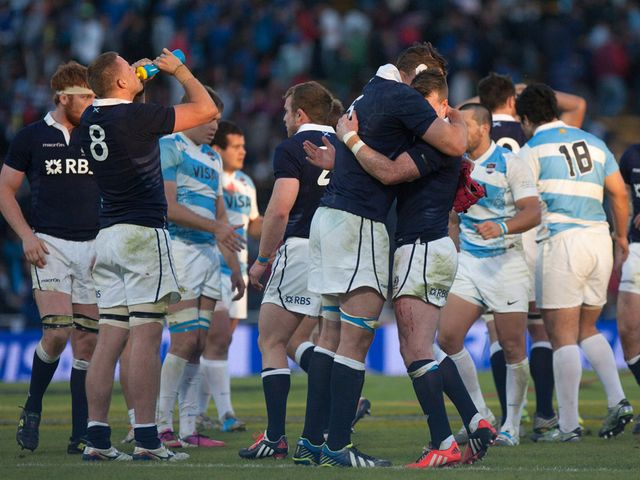 Scotland's players celebrate their last minute win over Argentina