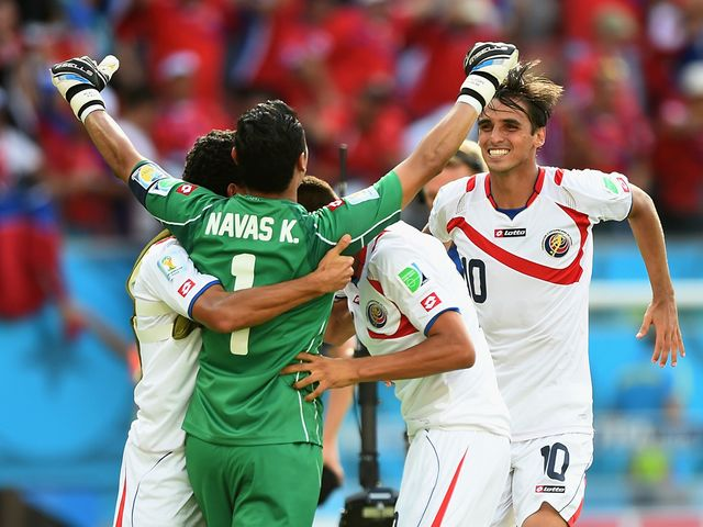 Costa Rica players celebrate after beating Italy 1-0