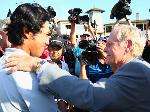 Hideki Matsuyama is congratulated by host Jack Nicklaus