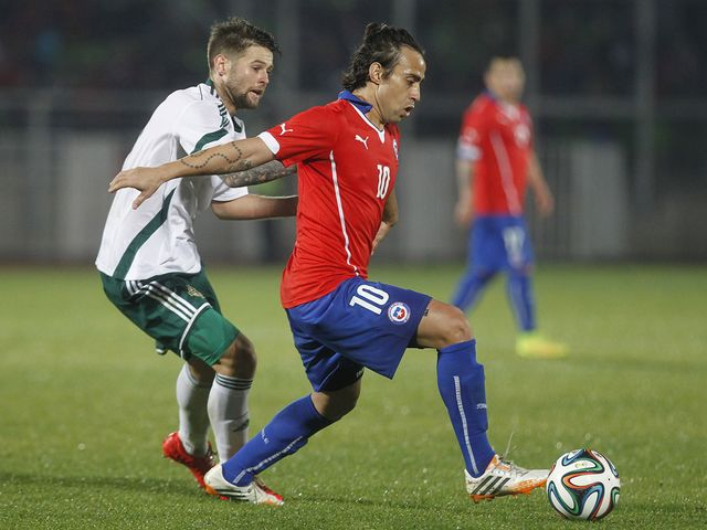 Chile's Jorge Valdivia holds off Corry Evans