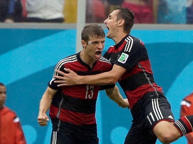 Germany's Thomas Muller celebrates with his teammate Miroslav Klose