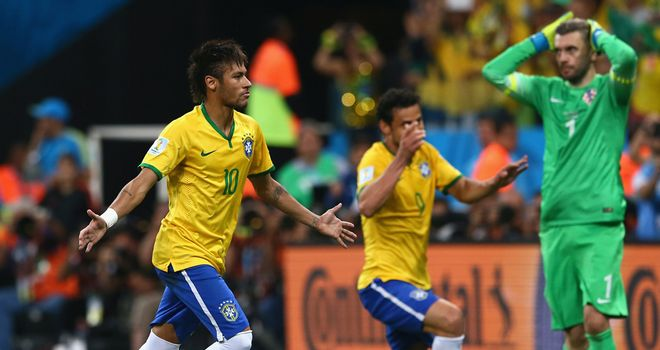Neymar celebrates after scoring from the spot