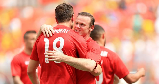 Rickie Lambert and Wayne Rooney: Celebrate during England's 2-2 draw with Ecuador
