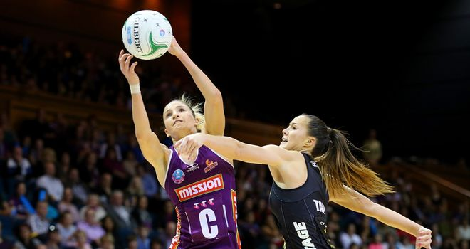 Kimberley Ravaillion of the Firebirds and Courtney Tairi of the Magic compete for the ball during the ANZ Championship Prelim Final