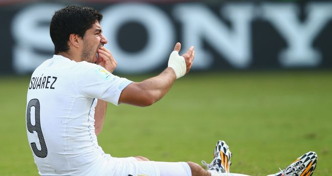 Luis Suarez: Banned for four months for biting Italy's Giorgio Chiellini