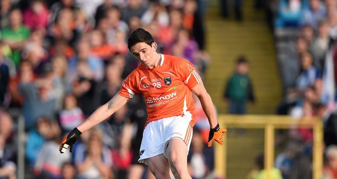 Rory Grugan converts an injury-time free to snatch a draw for Armagh
