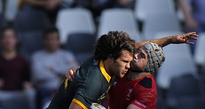 South African centre Jan Serfontein is tackled by Wales centre Jon Davies