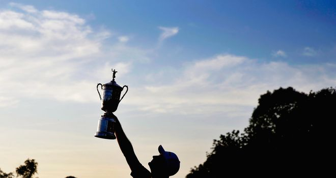 Justin Rose celebrates with the U.S. Open trophy after winning the 113th U.S. Open at Merion Golf Club in 2013