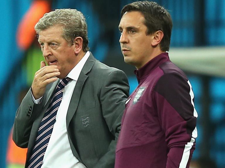 Roy Hodgson and Gary Neville look on