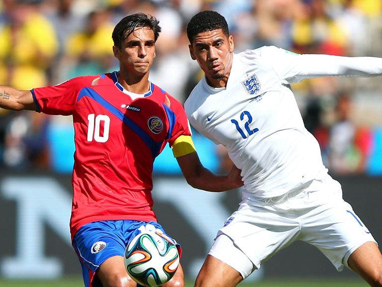 Chris Smalling (r) in action against Costa Rica