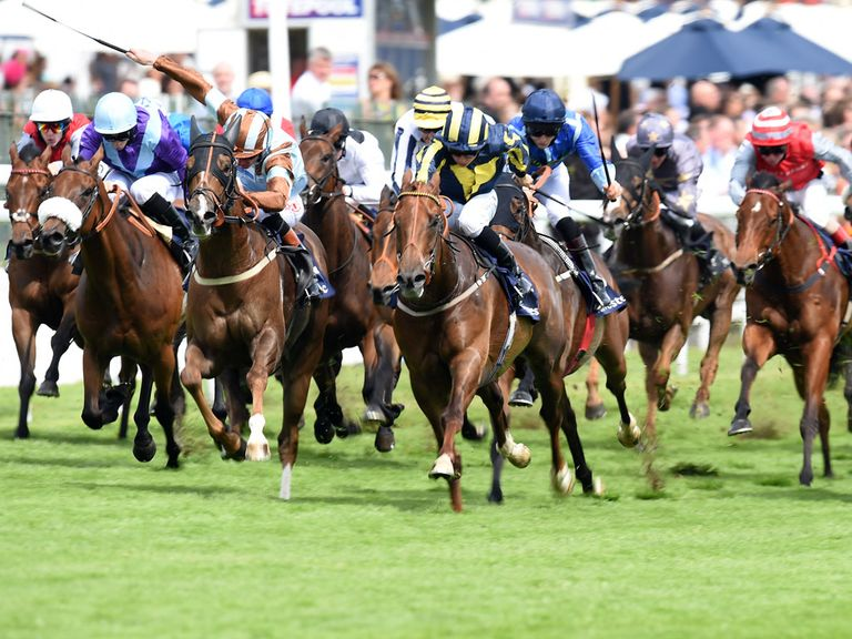 Caspian Prince ridden by Adam Kirby (second left) comes through to win the Investec Specialist Bank 'Dash'