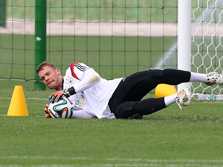 Goalkeeper Manuel Neuer makes a save during a training session