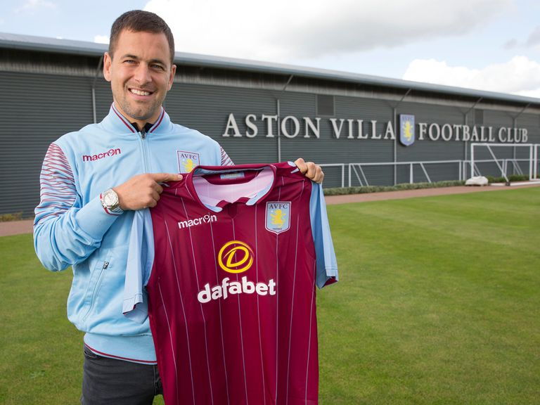 Joe Cole poses with an Aston Villa shirt after signing two-year deal