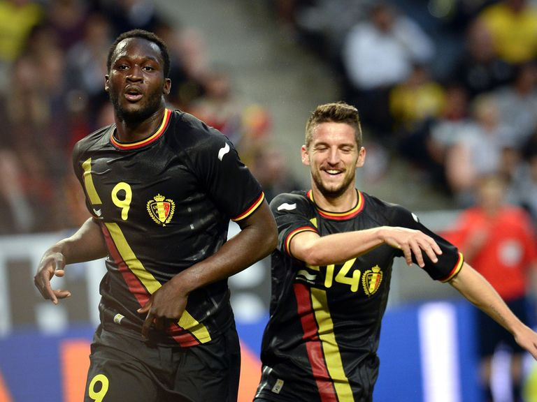 Belgium forward Romelo Lukaku celebrates with midfielder Dries Mertens