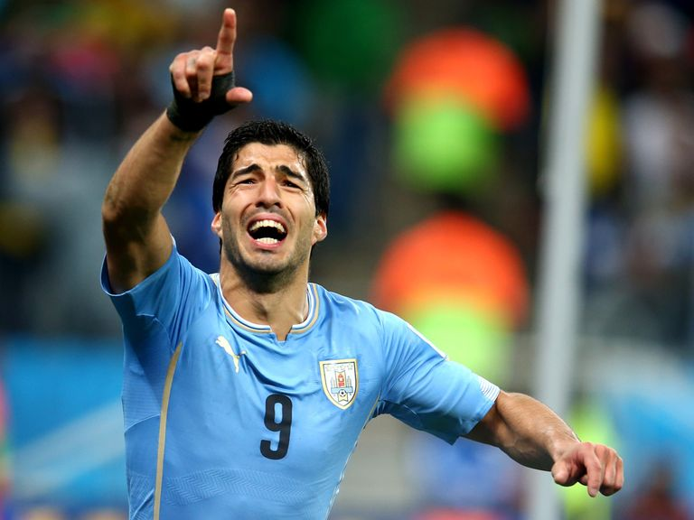 Luis Suarez celebrates after scoring against England