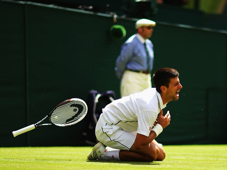 Novak Djokovic takes a tumble during his win over Simon