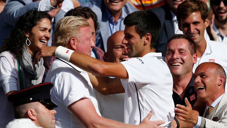 Novak Djokovic hugs Boris Becker after winning Wimbledon this year