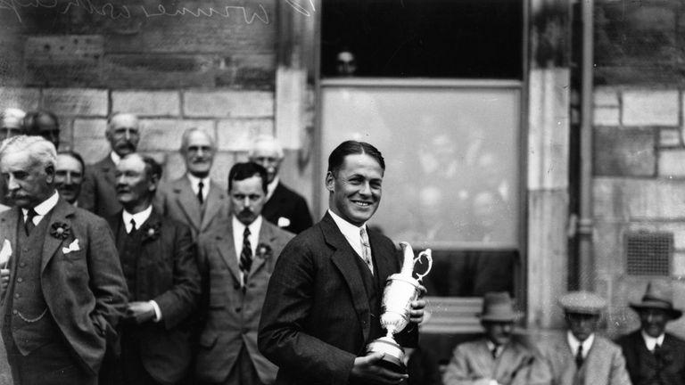 American golfer Bobby Jones (1902 - 1971) holding the Claret Jug