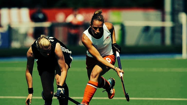 Elen (left) in action against England at the Commonwealth Games