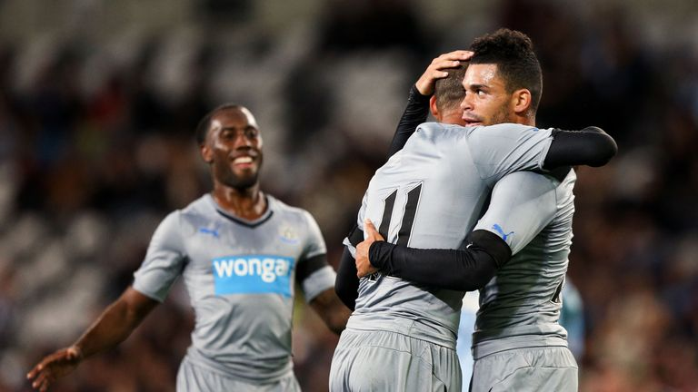 Emmanuel Riviere celebrates his first goal for Newcastle
