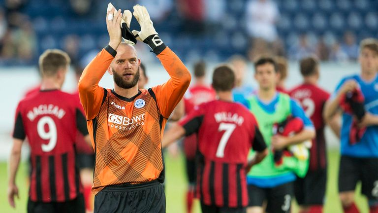 St Johnstone goalkeeper Alan Mannus applauds the fans at full-time