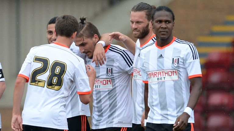 Fulham players celebrate a pre-season goal against Motherwell but will they be happy come May?