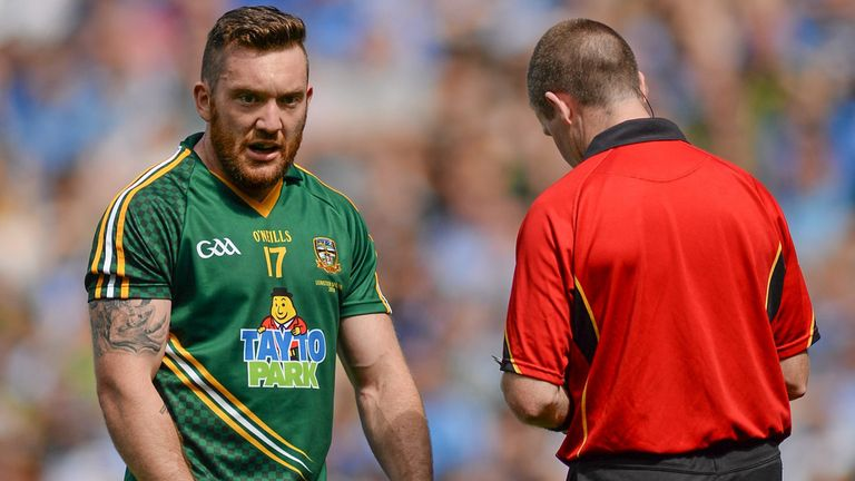 Meath defender Michael Burke is booked by referee Padraig Hughes during the loss to Dublin