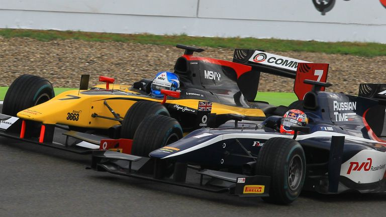 Palmer battles with Mitch Evans on wet tyres in the Sprint Race