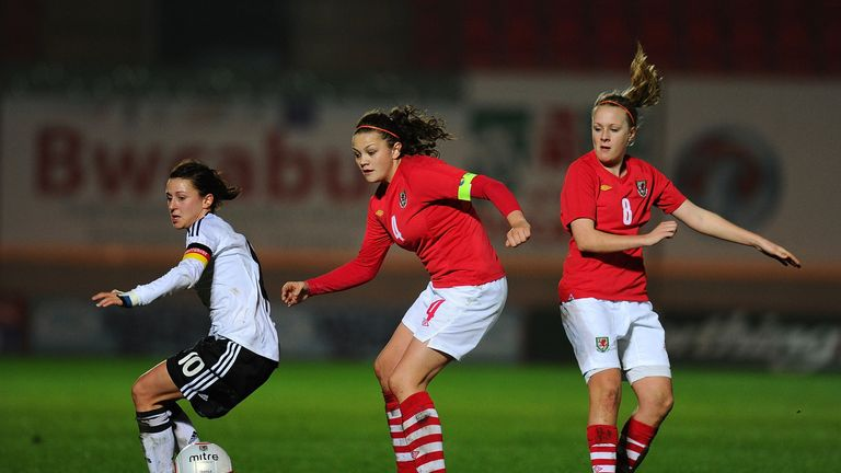 Multi-talented: Nia Jones (centre) plays international netball and football for Wales