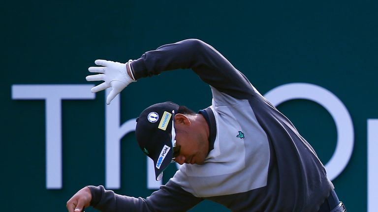 Twist and Shout: Yusaku Miyazato of Japan stretches on the first tee. Can he name The Beatles?