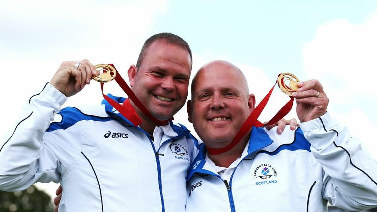 Paul Foster (L) and Alex Marshall (R) celebrate gold after the men's pairs final