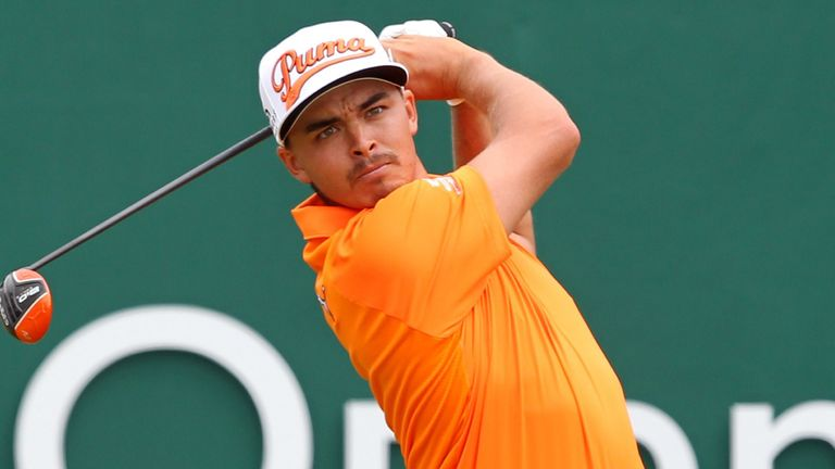 Rickie Fowler, in final-round orange, could not quite get close enough to challenge Rory McIlroy on Sunday