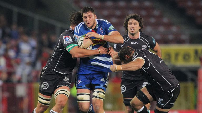 The Sharks defence gang-tackles Ruan Botha