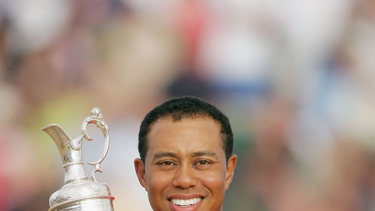 Tiger Woods with the Claret Jug after winning the Open at Hoylake in 2006