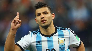 Sergio Aguero celebrates scoring his penalty kick against Holland