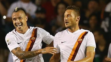 Francesco Totti: Celebrates netting the winner against Real Madrid