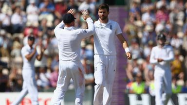 James Anderson (R) of England celebrates with Ian Bell after taking the wicket of Mohammed Shami - his fifth of the innings