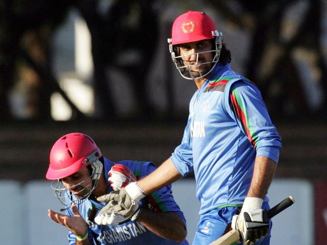 Afghanistan's Dawlat Zadran (l) and Shapoor Zadran celebrate