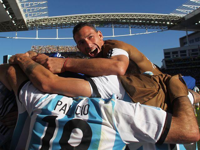 Argentina celebrate Di Maria's late winner