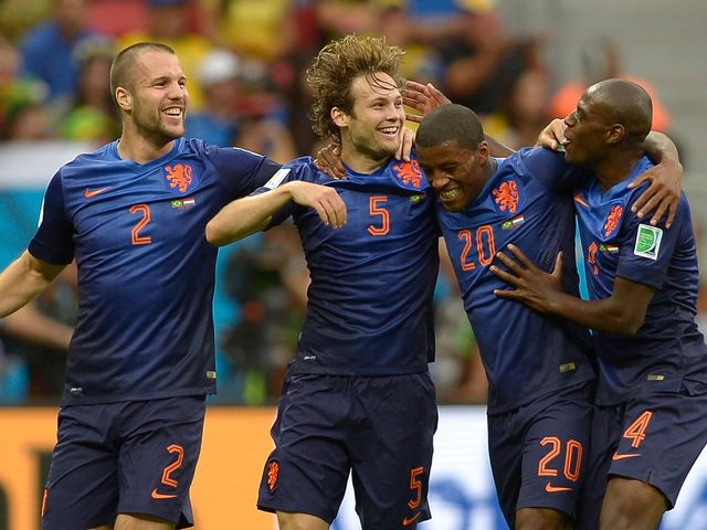 Holland celebrate victory over Brazil